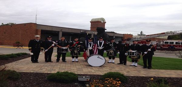Members of the Newton Fire Pipes and Drums